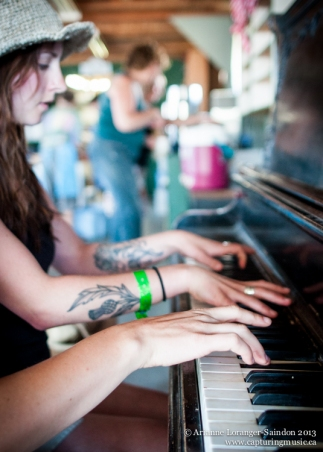 Leah and Jamie, playing piano in the Hospitality building during breakfast. Midsummer Music Festival, 2013.
